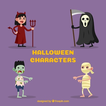 Colección de cuatro personas disfrazadas de halloween