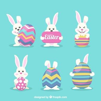 Colección de graciosos conejos de pascua con huevos