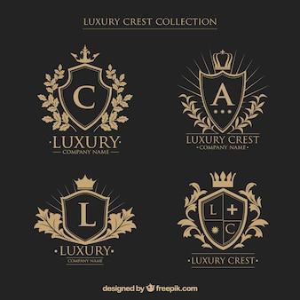 Colección de logos de escudos heráldicos con iniciales en estilo vintage