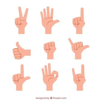 Colección de manos con diferentes posturas en estilo plano