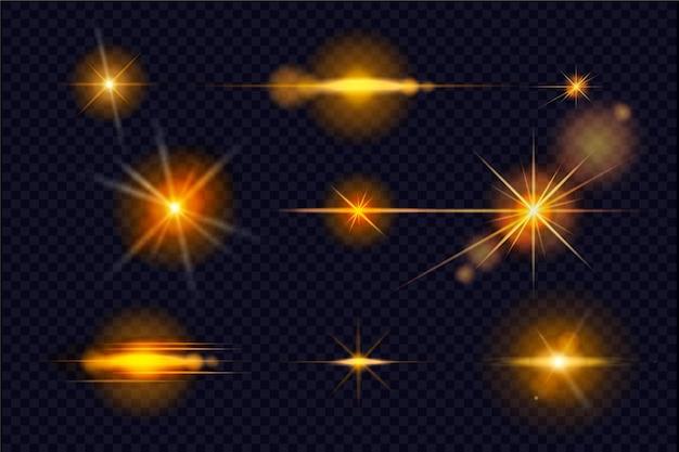 Colección de destellos de luz dorada