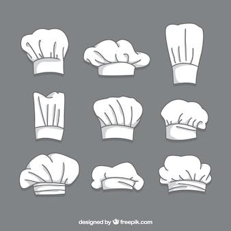 Colección dibujada a mano de nueve gorros de chef