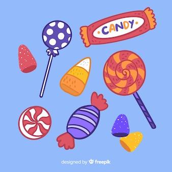 Colección de dulces de halloween dibujados a mano sobre fondo azul