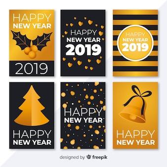 Colección elegante de tarjetas de año nuevo 2019 con estilo dorado