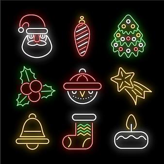 Colección de elementos de navidad de neón sobre fondo negro