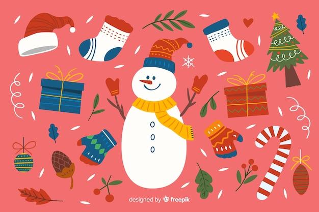 Colección de elementos navideños dibujados a mano sobre fondo rosa