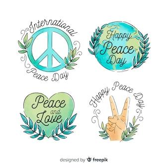 Colección de emblemas del día de la paz en acuarela