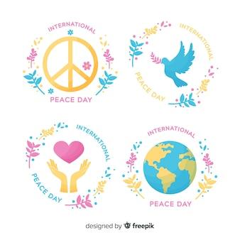 Colección de emblemas del día de la paz dibujadas a mano