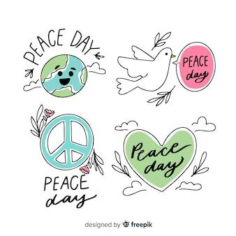 Colección de emblemas del día de la paz dibujado a mano