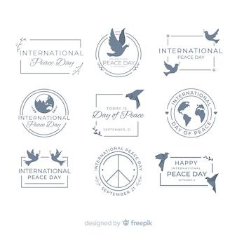 Colección de emblemas del día de la paz en diseño plano