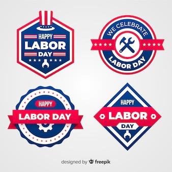Colección de emblemas del día del trabajador en diseño plano