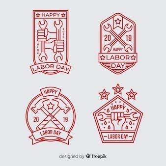 Colección de emblemas del día del trabajo en diseño plano