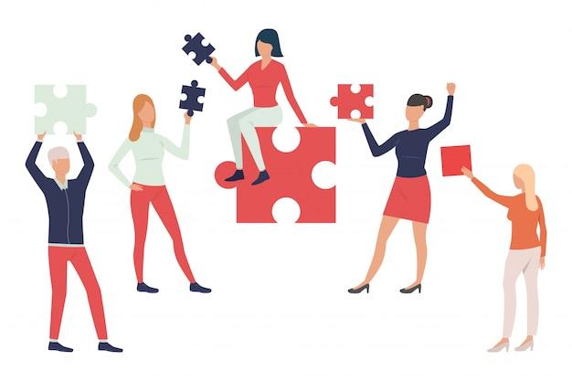 Colección de empresarios con piezas de puzzle.