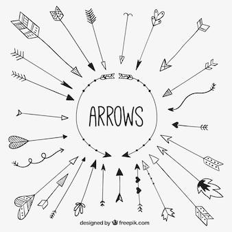 Colección esbozada de flechas