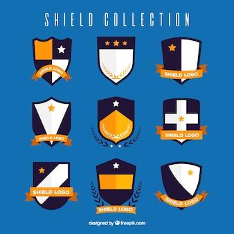 Colección de escudos heráldicos con detalles dorados