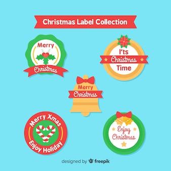 Colección de etiquetas navideñas de diseño plano