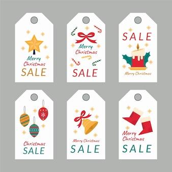 Colección de etiquetas de rebajas navideñas en diseño plano