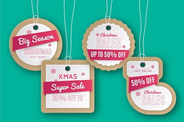 Colección de etiquetas de rebajas navideñas en estilo papel