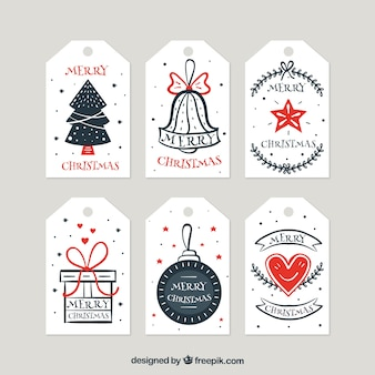 Colección de etiquetas retro de navidad dibujadas a mano
