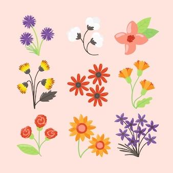 Colección de flores de primavera dibujada a mano aislada sobre fondo rosa