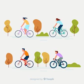 Colección gente montando en bicicleta en el parque