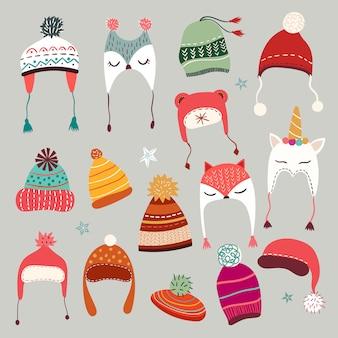 Colección de gorros de invierno con elementos de temporada dibujados a mano.