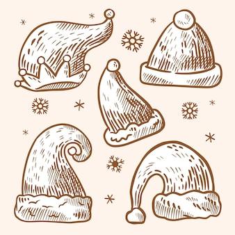 Colección de gorros de santa dibujados a mano