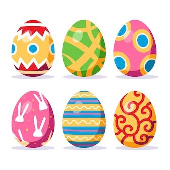 Colección de huevos de pascua decorativos planos coloridos