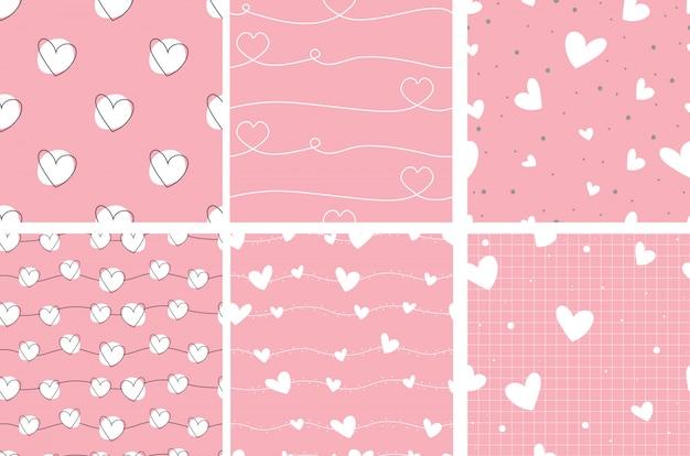 Colección inconsútil del modelo del corazón del doodle de la tarjeta del día de san valentín rosada