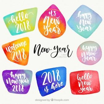 Colección de insignias de año nuevo 2018 en acuarela de diferentes colores