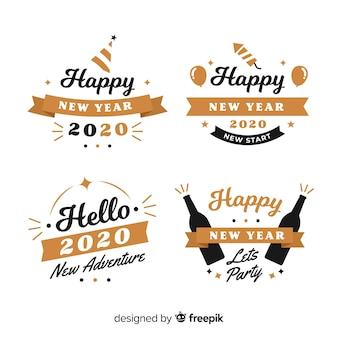 Colección de insignias de año nuevo de diseño plano