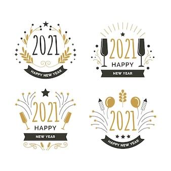 Colección de insignias de año nuevo en diseño plano
