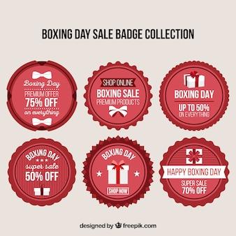 Colección de insignias del boxing day en tonos rojos