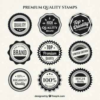 Colección de insignias de calidad en blanco y negro