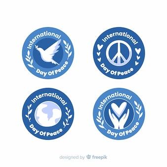 Colección de insignias de día de paz de diseño plano