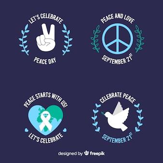 Colección de insignias del día de la paz plana sobre fondo oscuro
