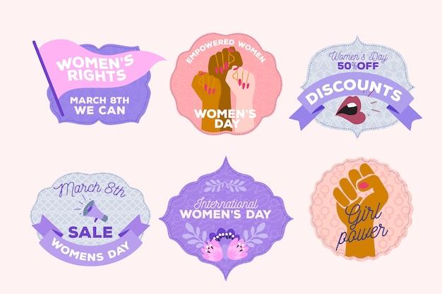 Colección de insignias de diseño plano con el día de la mujer