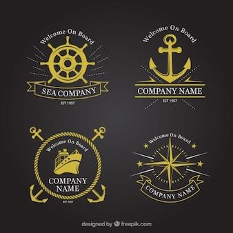 Colección de insignias doradas marineras