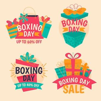 Colección de insignias de rebajas del día del boxeo dibujadas a mano