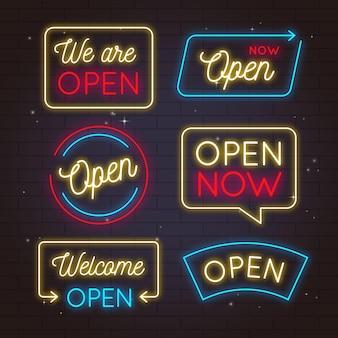Colección de letreros de neón con estamos abiertos