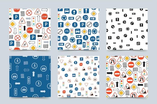 Colección de lindos patrones sin fisuras con señales de tráfico y semáforos sobre un fondo blanco.