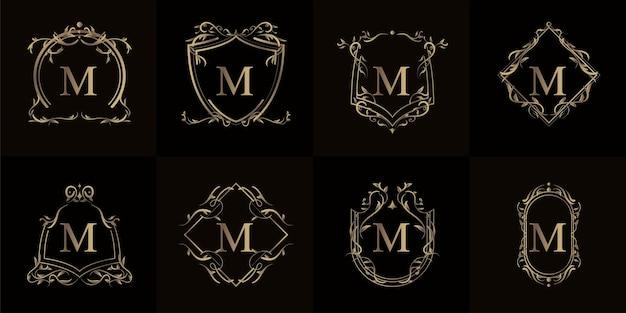 Colección de logo m inicial con marco de adorno de lujo