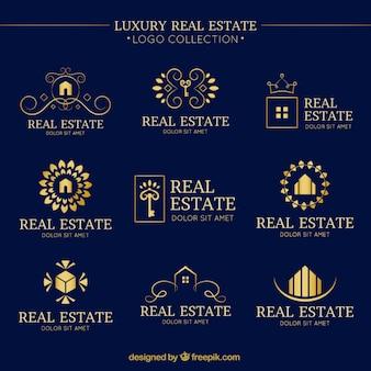 Colección de logos lujosos de inmobiliaria con detalles dorados