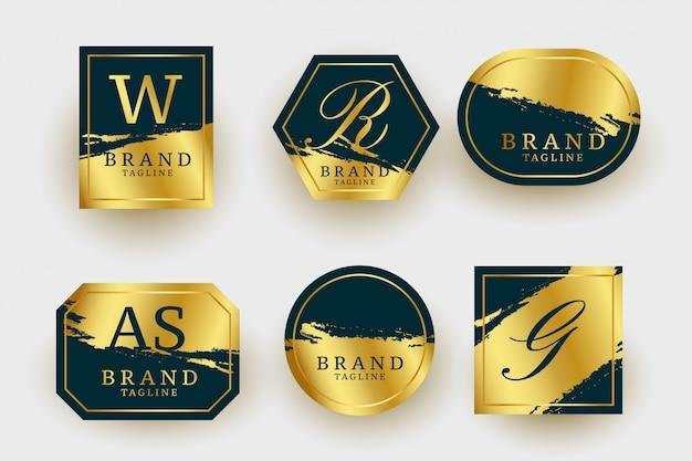 Colección de logotipos dorados de lujo geométricos