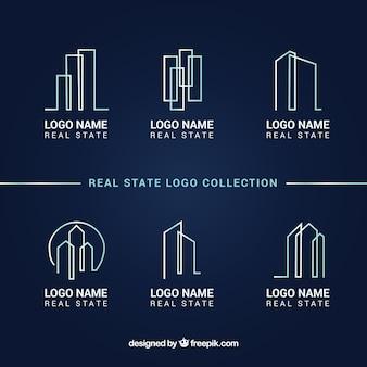 Colección de logotipos de inmobiliaria sobre un fondo azul oscuro