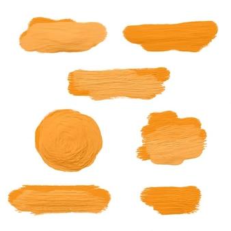 Colección de manchas de pintura acrílica naranja