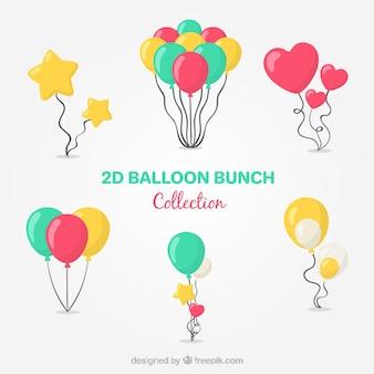 Colección de manojo de globos coloridos en estilo 2d