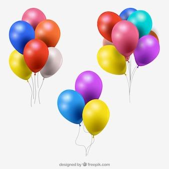 Colección de manojo de globos coloridos en estilo realista