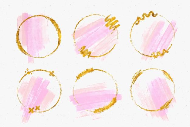 Colección de marcos dorados con trazos de pincel de acuarela