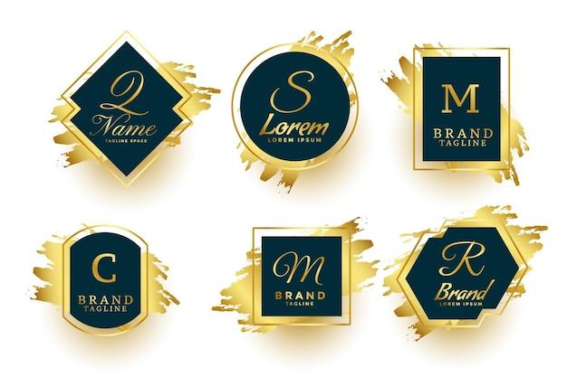 Colección de marcos de logotipo o símbolos de monogramas dorados abstractos